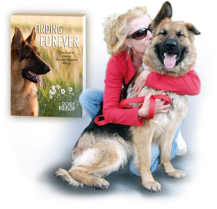 Dobie Houson hugging her dog with Finding Forever book cover in background
